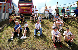Football fans sit outside the stadium prior to the Sky Bet Championship match at Elland Road, Leeds.