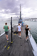 Tourists aboard the WW2 submarine, the USS Bowfin. USS Bowfin Submarine Museum and Park, part of the USS Arizona Memorial Museum in Pearl Harbour, Hawai. RIGHTS MANAGED LICENSE AVAILABLE FROM www.PhotoLibrary.com