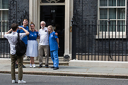 London, UK. 20th July, 2021. Matthew Tovey and other NHSPay15 campaigners pose outside 10 Downing Street with former Labour Party leader Jeremy Corbyn after presenting their petition signed by over 800,000 people calling for a 15% pay rise for NHS workers. At the time of presentation of the petition, the government was believed to be preparing to offer NHS workers a 3% pay rise in 'recognition of the unique impact of the pandemic on the NHS'.