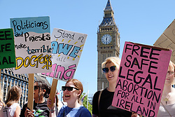 June 10, 2017 - London, England, United Kingdom - Protesters hold placards as they attend a demonstration against the Conservative party alliance with the DUP in Parliament Square on June 10, 2017 in London, England. After a snap election was called by Prime Minister Theresa May the United Kingdom went to the polls yesterday. The closely fought election has failed to return a clear overall majority winner and Theresa May has formed a minority Government with the support of Northern Ireland's Democratic Unionist Party. (Credit Image: © Jay Shaw Baker/NurPhoto via ZUMA Press)