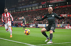 Manchester City's David Silva crosses the ball from the byline