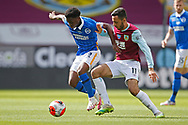 Brighton and Hove Albion defender Tariq Lamptey (2) and Dwight McNeil of Burnley (11)  contest a loose ball  during the Premier League match between Burnley and Brighton and Hove Albion at Turf Moor, Burnley, England on 26 July 2020.