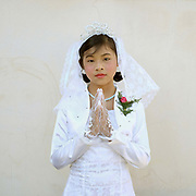 Portrait of an ethnic Kayah girl at her first communion at Christ the King Cathedral in Loikaw, Kayah State, Myanmar on 20th November 2016. In the past most people residing in Kayah State were traditional spirit worshippers, but significant numbers have converted to Christianity, especially Baptist or Catholic
