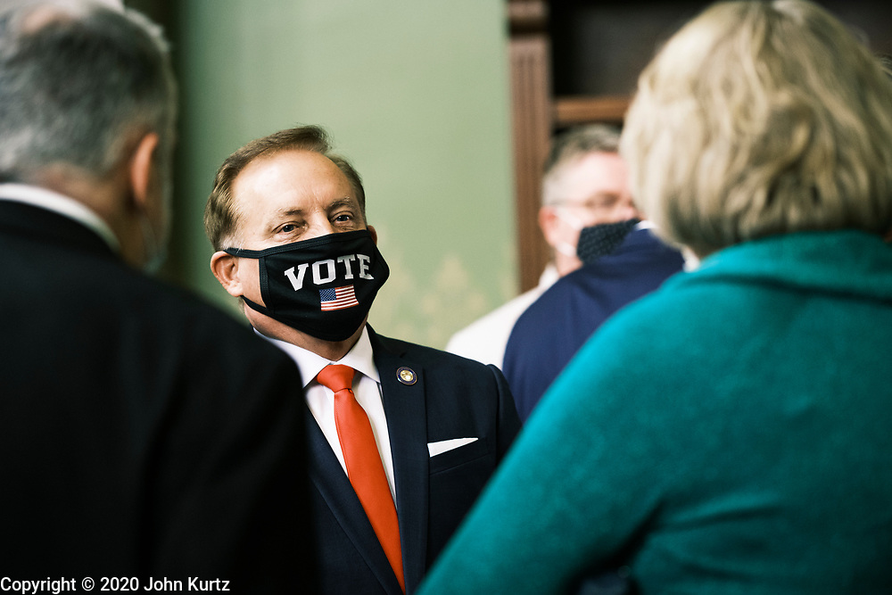 14 DECEMBER 2020 - DES MOINES, IOWA: PAUL PATE, Iowa's Secretary of State, talks to people in the Capitol before the Electoral College vote. Iowa's six Electors met at the State Capitol Monday and voted for President Donald Trump and Vice President Mike Pence, cementing Trump's victory in Iowa. Trump carried Iowa by 8.2 percent in the November 3 general election.     PHOTO BY JACK KURTZ