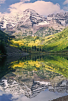 Reflections of Maroon Bells in Maroon Lake during the autumn season.  Elk Mountains, Colorado.  USA
