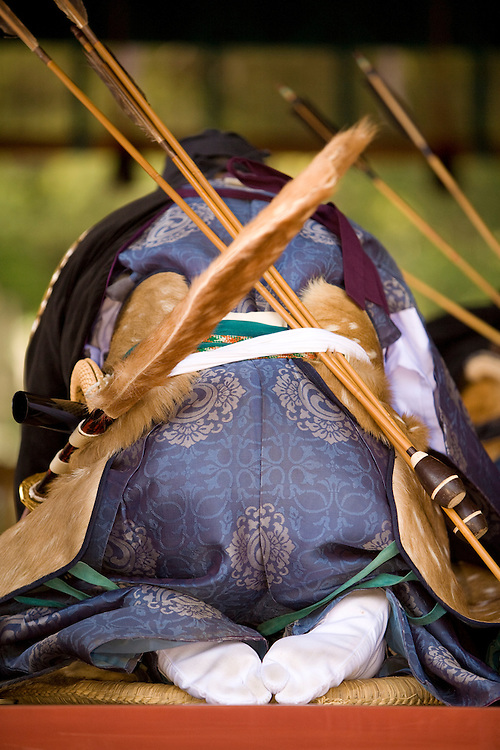 Asia, Japan, Honshu island, Kanagawa Prefecture, Kamakura, archer bows at prayer ceremony preceeding Yabusame, a revival of medieval samurai archery on horseback, at Kamakura Matsuri, an annual festival held at the Tsurugaoka Hachimangu shrine