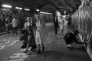 Partygoers going to - PARADISE LOST - <br /> the September Masked Ball<br />  the Waterloo Vaults, Leake St, an underground street underneath Waterloo station, London SE1
