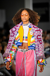 © Licensed to London News Pictures. 03/06/2018. LONDON, UK.  A model presents a look by Amy Bray from Plymouth College of Art on the opening day of Graduate Fashion Week taking place at the Old Truman Brewery in East London.  The event presents the graduation show of up and coming fashion designers from UK and international universities.  Photo credit: Stephen Chung/LNP