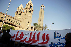 December 11, 2016 - Cairo, Cairo, Egypt - Egyptian Christians chant anti-terrorism slogans outside the the Saint Peter and Saint Paul Coptic Orthodox Church in Cairo's Abbasiya neighbourhood after it was targeted by a bomb explosion on December 11, 2016, . The blast killed at least 25 worshippers during Sunday mass inside the Cairo church near the seat of the Coptic pope who heads Egypt's Christian minority, state media said  (Credit Image: © Amr Sayed/APA Images via ZUMA Wire)