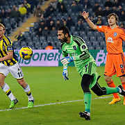 Fenerbahce's Dirk Kuyt (L) and Istanbul Basaksehir's goalkeeper Volkan Babacan (2ndR) during their Turkish superleague soccer match Fenerbahce between Istanbul Basaksehir at the Sukru Saracaoglu stadium in Istanbul Turkey on Saturday 03 January 2015. Photo by Aykut AKICI/TURKPIX