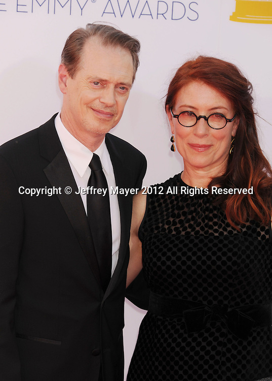 LOS ANGELES, CA - SEPTEMBER 23: Steve Buscemi and Jo Andres arrive at the 64th Primetime Emmy Awards at Nokia Theatre L.A. Live on September 23, 2012 in Los Angeles, California.