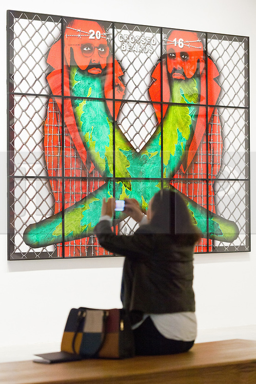 © Licensed to London News Pictures. 21/11/2017. London, UK. A visitor views artwork titled Crossed Birds by artists GEORGE PASSMORE and GILBERT PROUSCH otherwise known as GILBERT and GEORGE. The work is showing at the exhibition The Beard Pictures and Their Fuckosophy at the White Cube gallery. Photo credit: Ray Tang/LNP