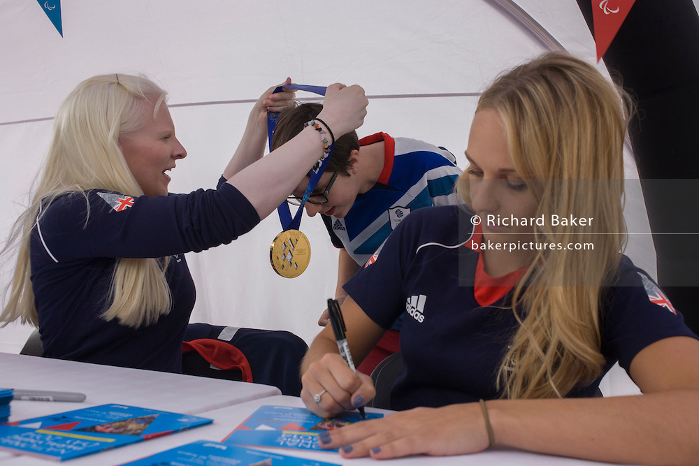 Partially-sighted skiing paralympian from the Sochi Olympics, Kelly Gallagher and her sighted guide Charlotte Evans at the National Paralympic Day, Stratford, London.