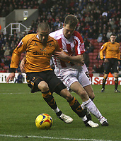 Photo: Mark Stephenson.<br />Stoke City v Wolverhampton Wanderers. Coca Cola Championship. 13/01/2007.<br />Wolves' Michael Kightly on the ball with Stoke's Clint Hill.