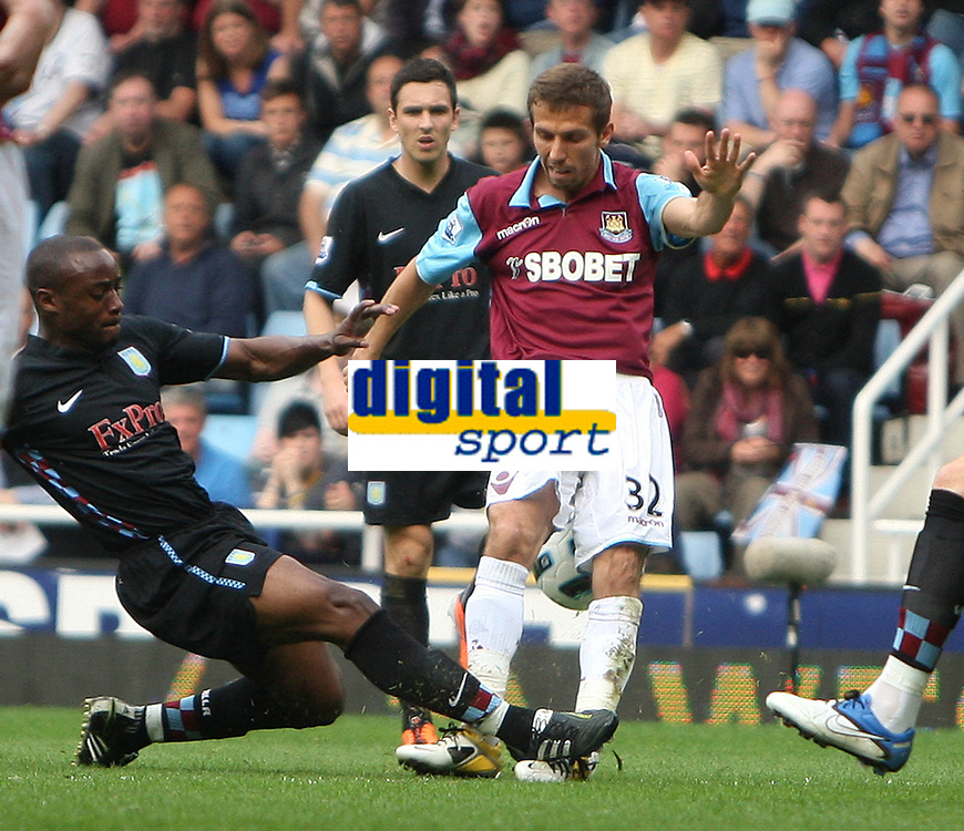 West Ham defender Gary O'Neil is allegedly thinking of suing Aston VIlla's Nigel Reo-Coker after this tackle led to O'Neil being stretchered off and rated only 50-50 by medical experts to resume his playing career.<br />FA Barclays Premiership. West Ham United v Aston Villa. 16.04.11<br />Photo By Karl Winter Fotosports International
