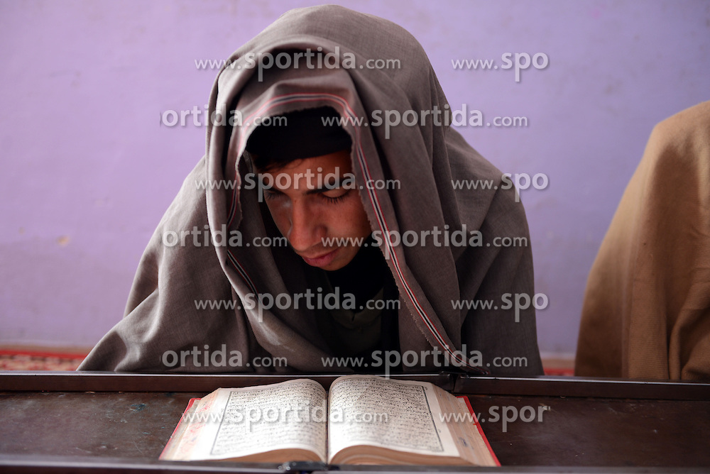 An Afghan boy reads Muslim holy book of Quran in Kandahar province, southern Afghanistan, Feb. 24, 2016. Afghan adolescents who do not have access to school often take religious lessons at local mosques in the countryside. EXPA Pictures © 2016, PhotoCredit: EXPA/ Photoshot/ Sanaullah Seiam<br /><br />*****ATTENTION - for AUT, SLO, CRO, SRB, BIH, MAZ only*****