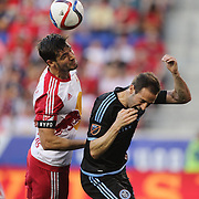Damien Perrinelle, (left), New York Red Bulls, and Pablo Alvarez, NYCFC, challenge for the ball during the New York Red Bulls Vs NYCFC, MLS regular season match at Red Bull Arena, Harrison, New Jersey. USA. 10th May 2015. Photo Tim Clayton