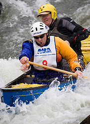 Matthew Dregne (front) of Verona, Wisconsin and Dave Hirsch of Sparta, Wisconsin race in the OC2 men's plastic class during the slalom course of the 42nd Annual Missouri Whitewater Championships. Dregne and Hirsch placed third place in the class. The Missouri Whitewater Championships, held on the St. Francis River at the Millstream Gardens Conservation Area, is the oldest regional slalom race in the United States.