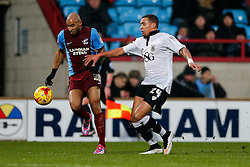 New loan signing James Tavernier of Bristol City is challenged by Marcus Williams of Scunthorpe United - Photo mandatory by-line: Rogan Thomson/JMP - 07966 386802 - 17/01/2015 - SPORT - FOOTBALL - Scunthorpe, England - Glanford Park - Scunthorpe United v Bristol City - Sky Bet League 1.