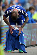 Aron Gunnarsson of Cardiff city wipes the ball with a towel as he prepares to take a long throw-in. EFL Skybet championship match, Cardiff city v Reading at the Cardiff city stadium in Cardiff, South Wales on Saturday 27th August 2016.<br /> pic by Andrew Orchard, Andrew Orchard sports photography.