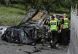 June 27, 2017 - Kiev, Ukraine - Policemen and investigators inspect the site of car blast in Kiev, capital of Ukraine. A senior Ukrainian intelligence officer was killed on Tuesday in a car blast in the capital city of Kiev. The Defense Ministry identified the victim as Col. Maxim Shapoval of the Chief Directorate of Intelligence and Special Forces. (Credit Image: © Chen Junfeng/Xinhua via ZUMA Wire)