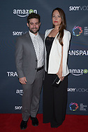 JOE LEWIS (L) and YARA MARTINEZ at the premiere of Amazon's 'Transparent' season two at the Pacific Design Center in Los Angeles, California