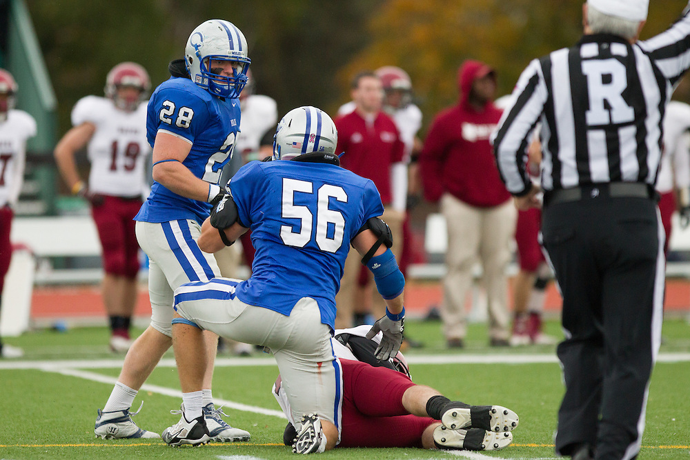 Harry Nicholas and Caleb Harris, of Colby College, record a sack in a NCAA Division III football game against Bates College on October 26, 2013 in Waterville, ME. (Dustin Satloff/Colby College Athletics)