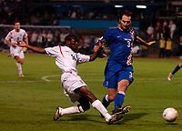 Photo: Richard Lane.<br />Croatia v England. UEFA European Championships 2008 Qualifying. 11/10/2006. <br />England's Shaun Wright-Phillips shots as Josip Simunic challenges.