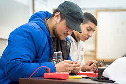25 February 2020, Jerusalem: 16-year-old students Omar Mohsen (left) and Jafar Salameh (right) from Beit Hanina participate in telecommunication class at the vocational training centre in Beit Hanina. The Lutheran World Federation's vocational training centre in Beit Hanina offers vocational training for Palestinian youth across a range of different professions, providing them with the tools needed to improve their chances of finding work.