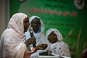 As others wait her to finish her speech, a Sudanese woman has the opportunity to speak her mind from the stage while attending the first-ever international Conference on Womens' Challenge in Darfur, gather in a compound belonging to the Govenor of Noth Darfur in Al Fasher (also spelled, Al-Fashir) where the women from remote parts of Sudan gathered to discuss peace and political issues.