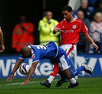 Photo: Steve Bond.<br /> Leicester City v Barnsley. Coca Cola Championship. 27/10/2007. Collins John (L) is dumped by Lewin Nyatanga (R)