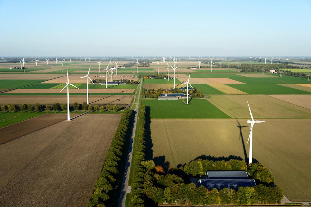 Nederland, Flevoland, Zeewolde, 24-10-2013; boerderij met zonnepanelen aan de Schollevaarweg (ten noorden van Zeewolde), omgeven door windmolens van een windmolenpark (windpark).<br /> Farm with solar panels in Flevopolder, surrounded by wind turbines of a wind farm <br /> luchtfoto (toeslag op standard tarieven);<br /> aerial photo (additional fee required);<br /> copyright foto/photo Siebe Swart