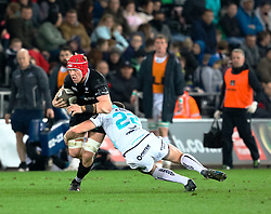 Ospreys' Sam Cross is tackled by Connacht's Craig Ronaldson<br /> <br /> Photographer Simon King/Replay Images<br /> <br /> Guinness PRO14 Round 19 - Ospreys v Connacht - Friday 6th April 2018 - Liberty Stadium - Swansea<br /> <br /> World Copyright © Replay Images . All rights reserved. info@replayimages.co.uk - http://replayimages.co.uk