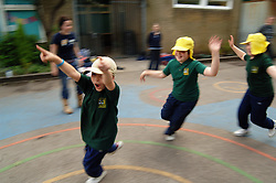 Children exercise with games as part of the after school 'Green Gym' activity a pilot scheme run by the BTCV; All Saints Primary School; Cross Green; Leeds,