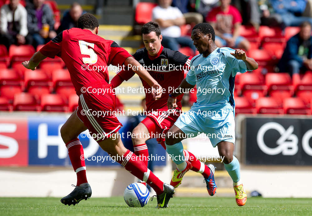 St Johnstone v Bristol City....28.07.12  Pre-Season Friendly<br /> Trialist Keammar Daley is closed down by Lewin Myatanga and Greg Cunningham<br /> Picture by Graeme Hart.<br /> Copyright Perthshire Picture Agency<br /> Tel: 01738 623350  Mobile: 07990 594431