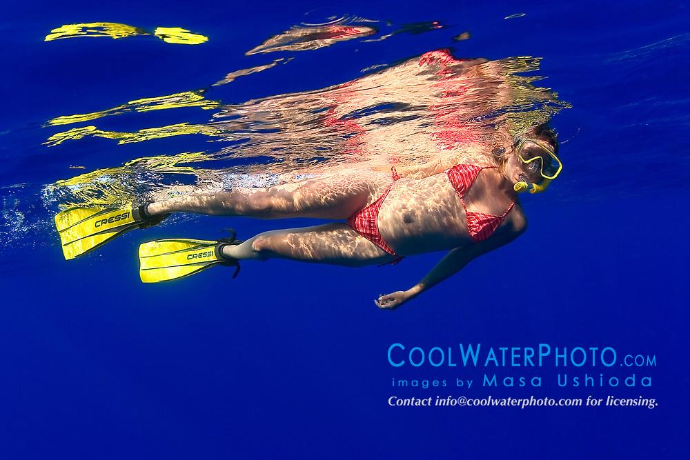 woman snorkeler in deep blue water, offshore, Kona, Big Island, Hawaii, Pacific Ocean