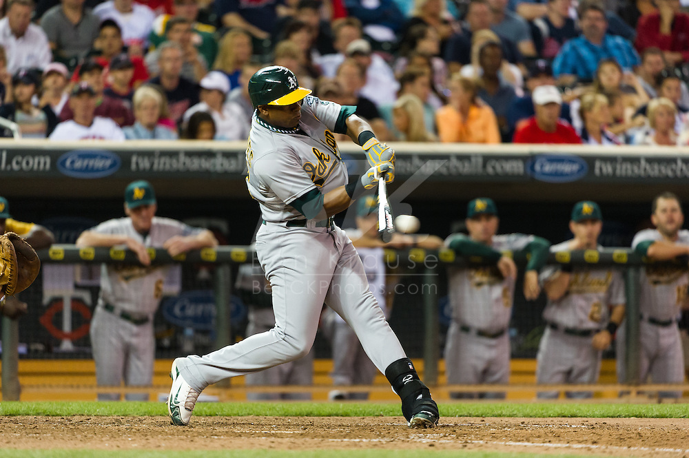 Oakland Athletics Yoenis Cespedes bats against the Minnesota Twins on July 13, 2012 at Target Field in Minneapolis, Minnesota.  The Athletics defeated the Twins 6 to 3.  © 2012 Ben Krause