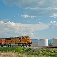 Locomotives pull a coal train through Bozeman, Montana.  With rising coal exports to China, as many as 40 of these may soon pass through the town, gridlocking traffic.