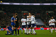 Christian Eriksen of Tottenham Hotspur (c) celebrates with his team mates after he scores his teams 4th goal. <br /> Premier league match, Tottenham Hotspur v Everton at Wembley Stadium in London on Saturday 13th January 2018.<br /> pic by Kieran Clarke, Andrew Orchard sports photography.