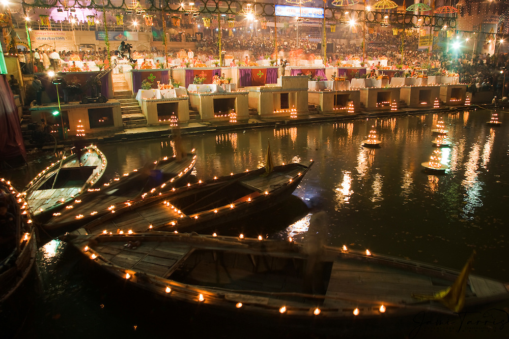 The main Dasaswamedh ghat on the Ganges River decorated and lit with candles during a festival, Varanasi, Uttar Pradesh, India
