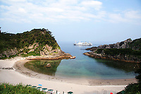 Tomari Beach, Shikinejima - The northern corner of Shikinejima Island is where the stunning Tomari Beach is found. This quiet fan-shaped inlet has shallow waters, making it the ideal place swimmers.
