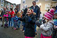The excitement of seeing Santa and Mrs. Claus was on the faces of Aria Capone and Arya Zimmerman during the Light Up Laconia Holiday Parade on Sunday afternoon.  (Karen Bobotas/for the Laconia Daily Sun)