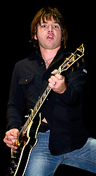 Quireboys lead guitarist luke bossendorfer performing on stage at the Monsters of Rock Festival. The last night of an eleven date tour at the Hallam FM Arena, Sheffield on Tuesday 26th November 2002<br />