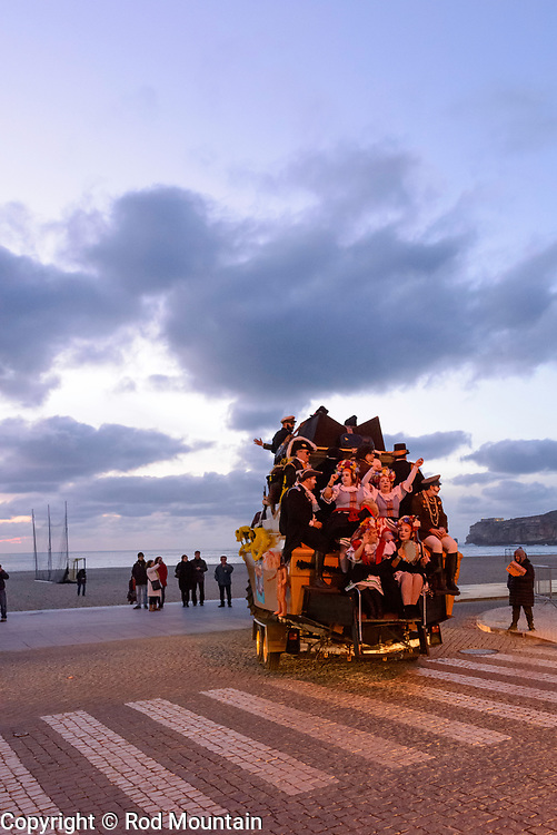 Nazaré, Portugal - February 12, 2018 - Nazaré Festival 06 - Carnaval is celebrated in Nazare and throughout Portugal. Costumed parades and plenty of music! <br /> <br /> Image: © Rod Mountain<br /> <br /> http://www.rodmountain.com<br /> http://bit.ly/Nazaré_bw<br /> http://bit.ly/Nazare_Portugal<br /> <br /> Nikon D800 / Nikkor Lens<br /> @nikoncanada #NikonCA<br /> @NikonUSA #NikonNoFilter<br /> @nikoneurope #NikonEurope<br /> <br /> https://www.visitportugal.com/en<br /> @visitportugal <br /> <br /> https://en.wikipedia.org/wiki/Nazaré,_Portugal<br /> http://www.cm-nazare.pt/en<br /> @municipiodanazare @cmnazare @CMNazareMata <br /> <br /> #turismoemportugal #turismo #rotaportugal <br /> #awesomebnw #folkgood #traveldeeper #tourism<br /> <br /> #worldcaptures #justgoshoot #TheGlobeWanderer #everydayportugal #travelblog#instago #ourstreets #carnaval #blackandwhite #blackandwhitephotography<br /> <br /> #bwmasters #blacknwhitepic #bnw_captures #bnw_universe #bwsquare #FriendsinBNW #friendsinstreets #featuremeinstagood #travelblog#instago<br /> <br /> <br /> https://en.wikipedia.org/wiki/Carnival <br /> https://en.wikipedia.org/wiki/Portugal