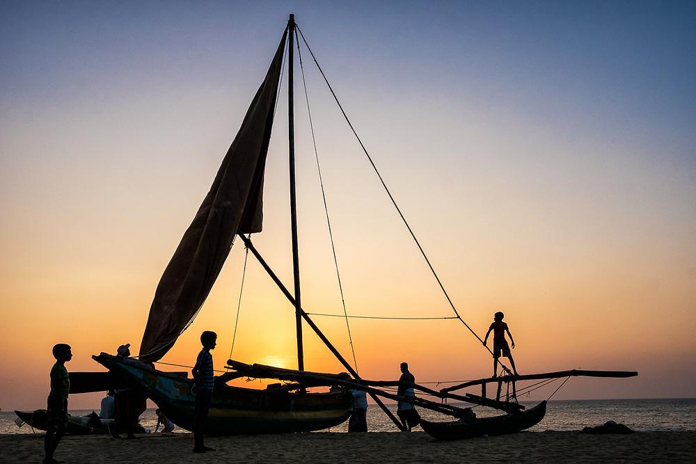 Sri Lanka - Silhouettes on Negombo beach at sunset. Photo by Lorenz Berna