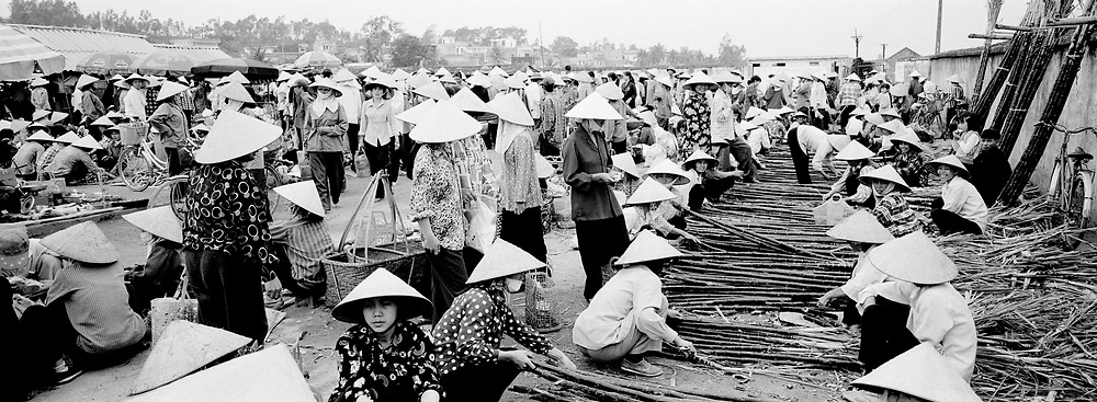 Ladies selling Bamboo at crowded market