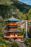 "Seiganto-ji (Temple of the Blue Waves) is a Tendai Buddhist temple within the Kumano Sanzan shrine complex, in Nachikatsuura, on the Kii Peninsula, on the island of Honshu, Japan. Don't miss the iconic view of thundering Nachi-no-Taki waterfall (133 m, Japan's tallest) paired with Seiganto-ji pagoda. According to a legend, it was founded (near a previous nature worship site) by the priest Ragyo Shonin, a monk from India. Seiganto-ji is part of the Kumano Sanzan shrine complex and is one of the few jingu-ji still in existence after the separation of Shinto and Buddhism forced by the Japanese government during the Meiji restoration. Seiganto-ji is is stop #1 on Kansai Kannon Pilgrimage, and is part of a UNESCO World Heritage Site listed as the ""Sacred Sites and Pilgrimage Routes in the Kii Mountain Range"". Access: by bus from Nachi Station (20 min) or Kii-Katsuura Station (30 min). Ask driver to stop at base of the Daimonzaka trail (""Daimonzaka"" stop); or at the entrance to Nachi Waterfall (""Taki-mae""); or at the bus terminus 10 minutes climb below Nachi Shrine (""Nachi-san""). Cars can park at Seigantoji Temple. I recommend this scenic, short walk (3.5 km with 265 meters gain): starting from Daimon-zaka bus stop, ascend a stone-paved path, humbled by massive evergreens, up to the gates of Nachi Taisha shrine, descend to Seiganto-ji pagoda, then to the falls, just below Taki-mae bus stop."