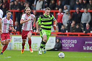 Forest Green Rovers Lee Collins(5) brings the ball out of defence during the EFL Sky Bet League 2 match between Stevenage and Forest Green Rovers at the Lamex Stadium, Stevenage, England on 21 October 2017. Photo by Adam Rivers.