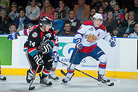 KELOWNA, CANADA - NOVEMBER 9: Tyson Baillie #24 of the Kelowna Rockets checks Riley Kieser #14 of the Edmonton Oil Kings during first period action on November 9, 2013 at Prospera Place in Kelowna, British Columbia, Canada.   (Photo by Marissa Baecker/Shoot the Breeze)  ***  Local Caption  ***