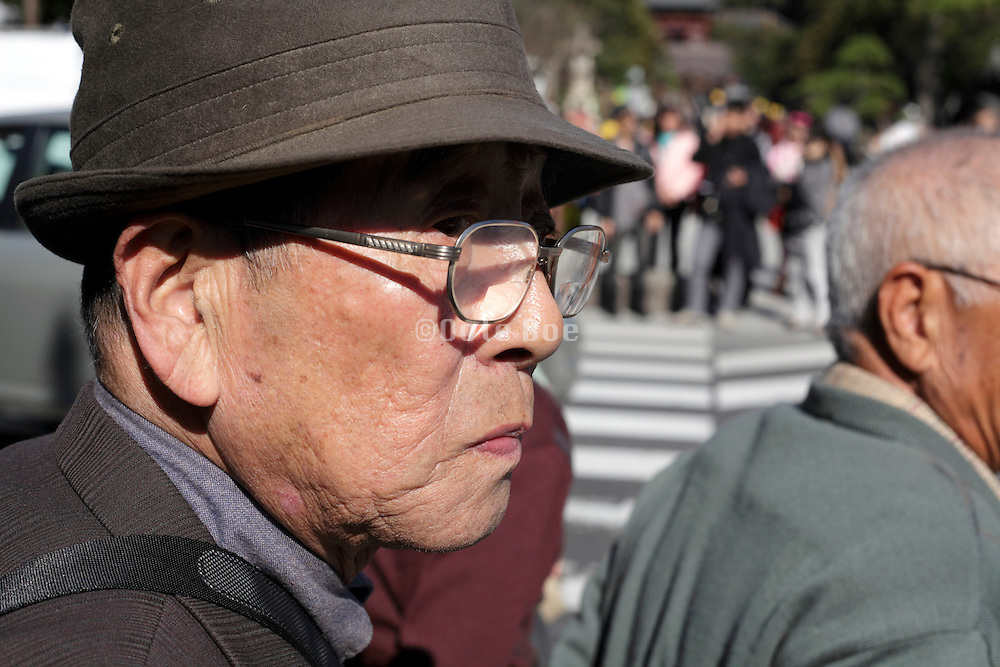 portrait of senior Japanese man on day trip with friends